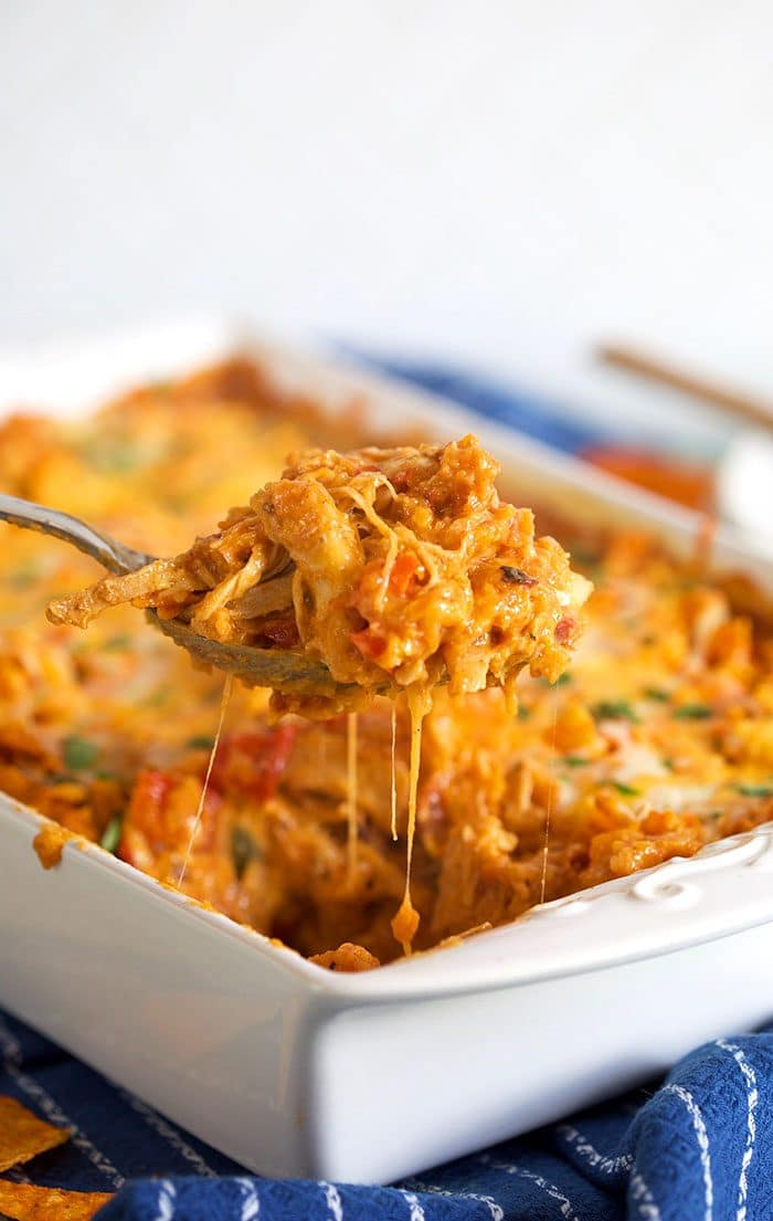 Dorito Chicken Casserole being served from a white baking dish.