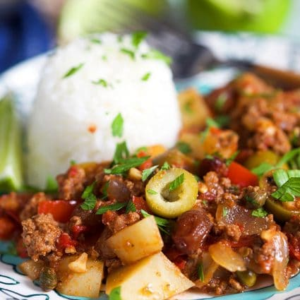 Easy Picadillo on a teal floral plate with rice.