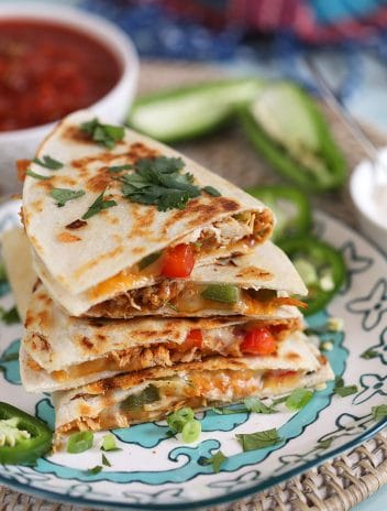 Stack of chicken quesadillas on a plate.