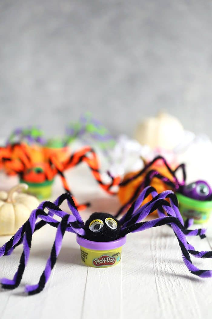 Play Doh spiders on a white background.
