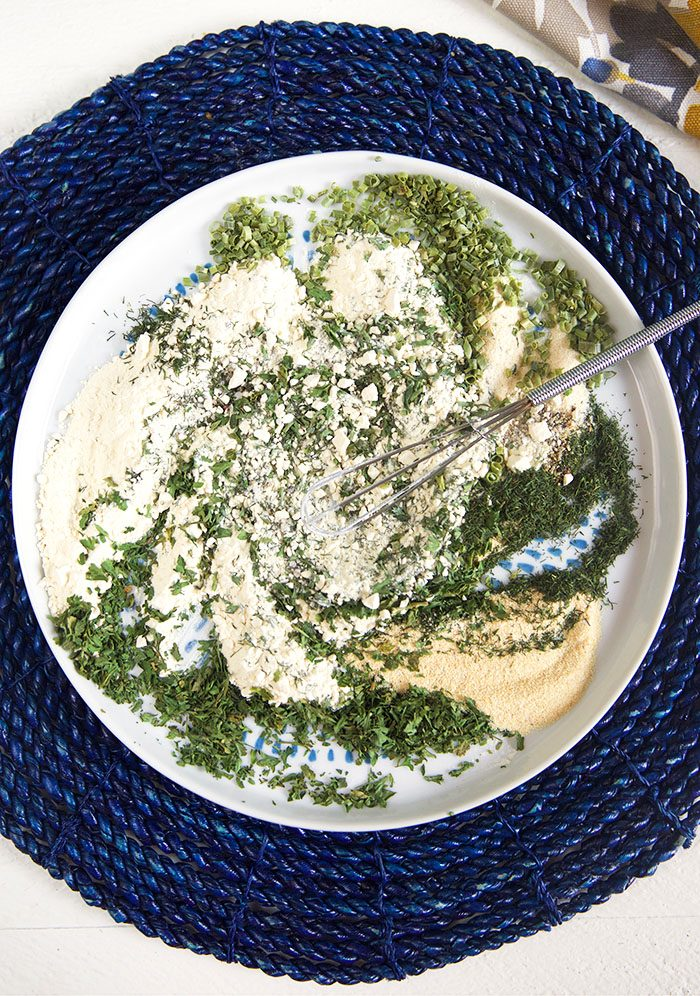 Ranch seasoning mix on a plate that's been whisked together.
