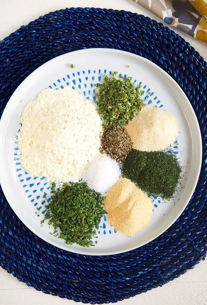 Overhead shot of ranch seasoning ingredients on a round plate.
