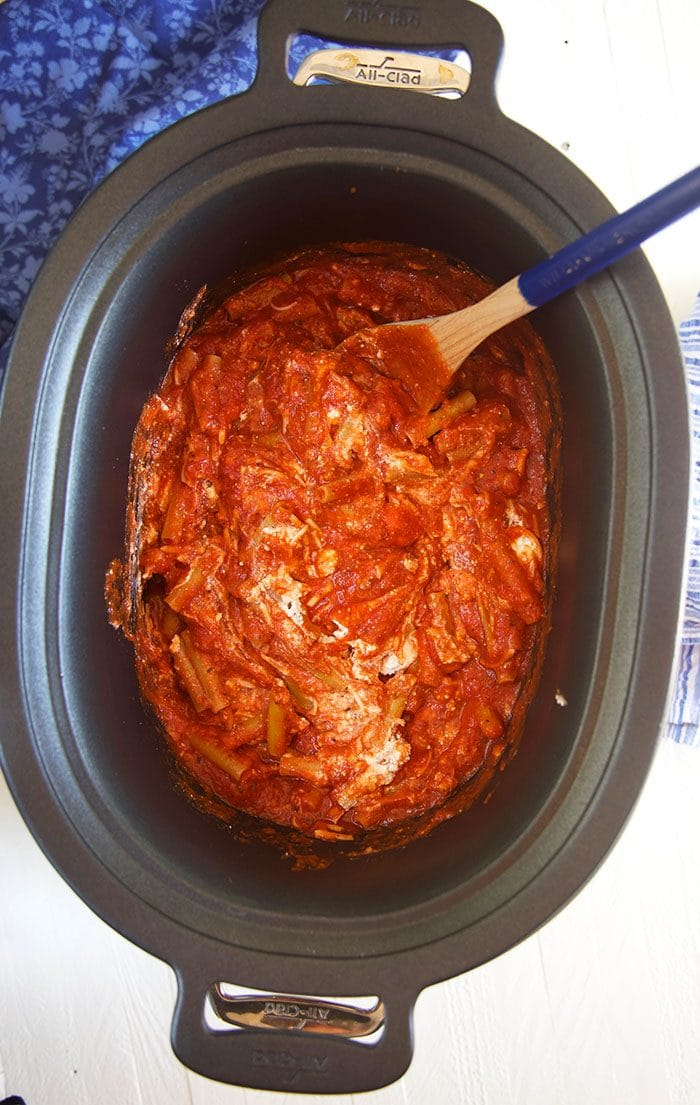 ziti and sauce in a slow cooker.