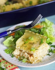 Pierogi Casserole on a white plate with a green salad.