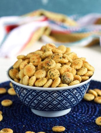 Ranch seasoned oyster crackers in a blue and white bowl.