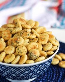 Ranch oyster crackers in a blue and white bowl on a blue background.