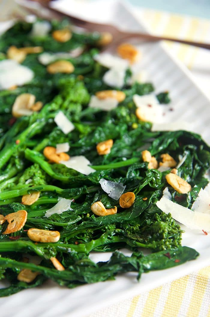 Broccoli Rabe with garlic on a white platter.