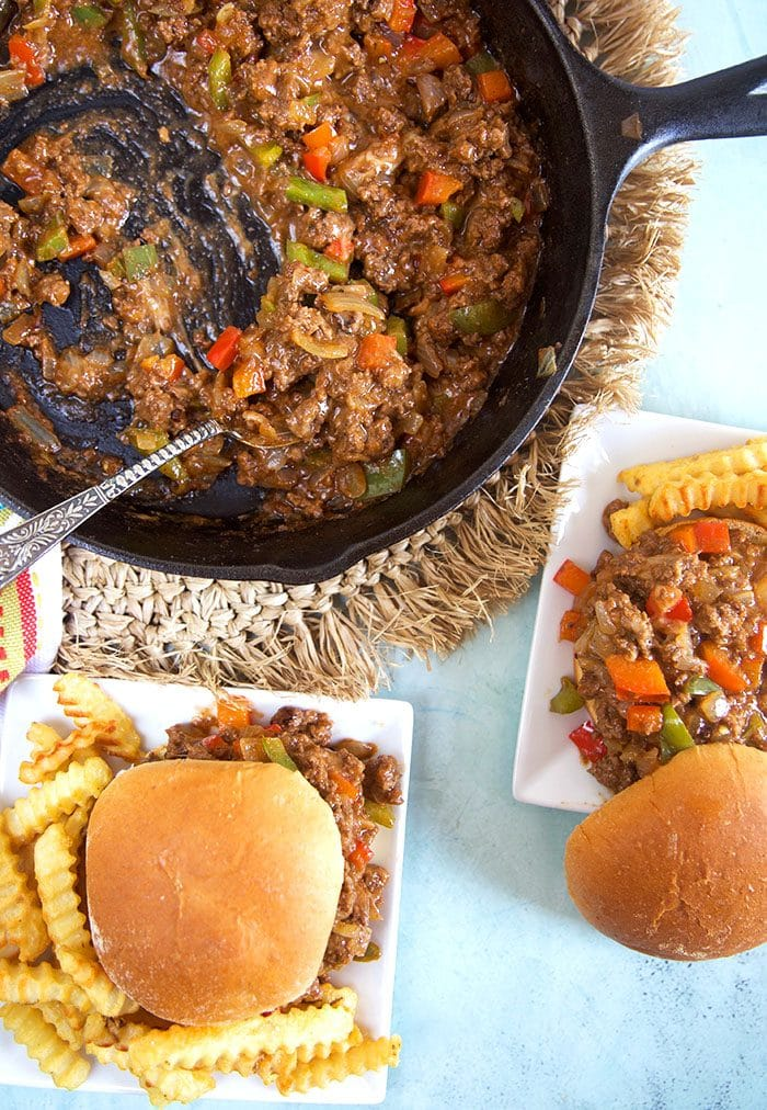 Overhead shot of philly cheesesteak sloppy joes on a plate