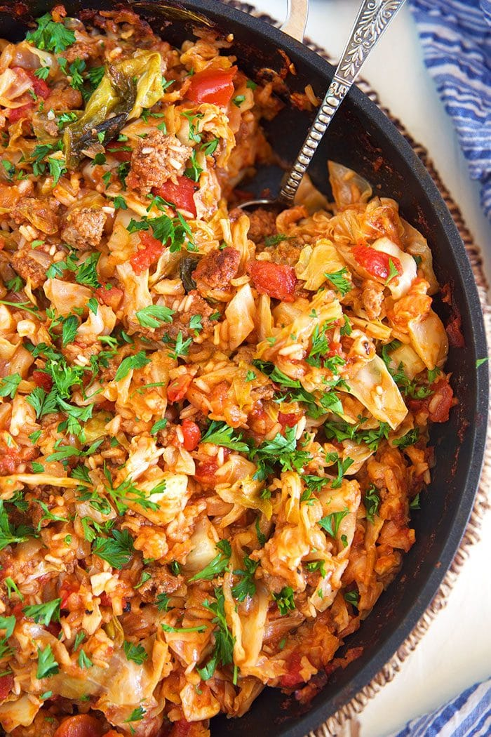 Close up of stuffed cabbage casserole in a skillet.