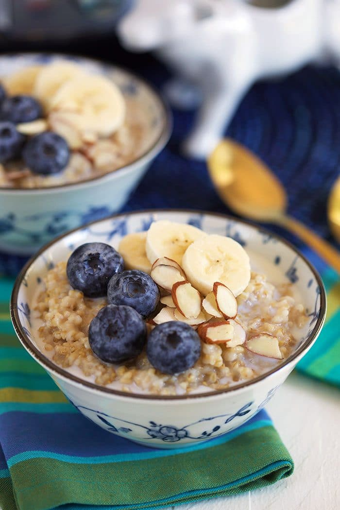 Steel Cut Oatmeal in a bowl with blueberries, bananas and almonds.