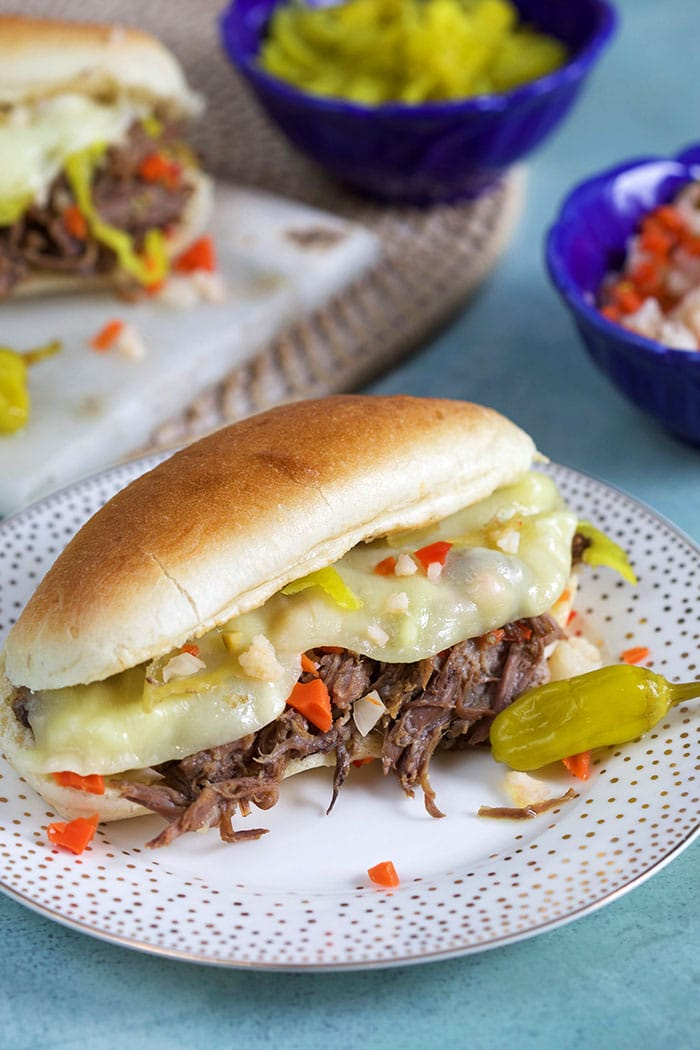 Shredded Italian Beef on a long roll with giardiniera and melted cheese.