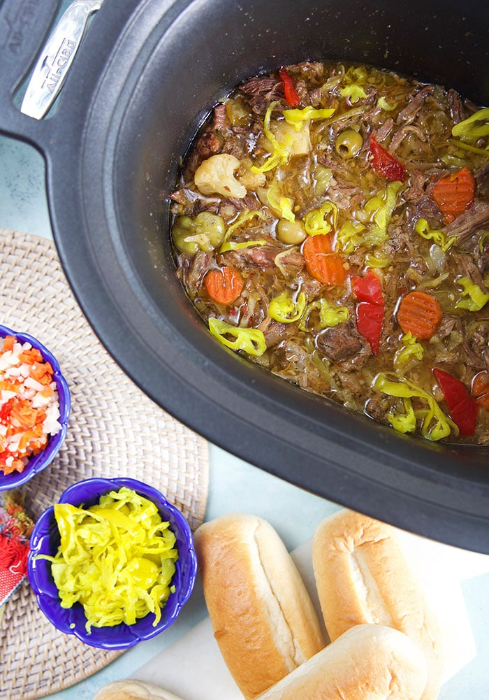 Overhead shot of italian beef in a slow cooker.