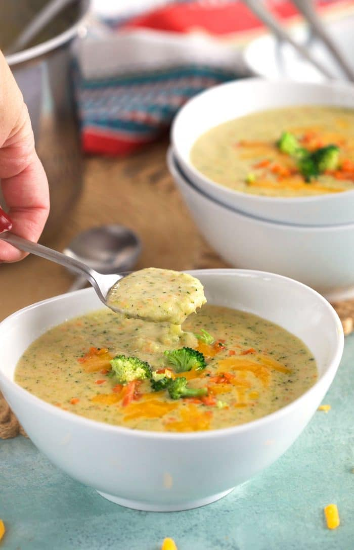 Broccoli Cheddar Soup with a spoon scooping some out of a bowl.