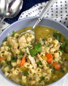 Pesto Chicken Noodle Soup in a gray bowl.