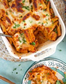 overhead shot of baked rigatoni in a white baking dish.