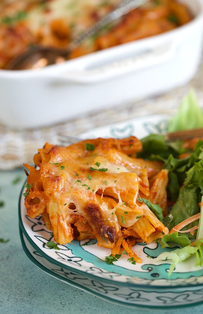 Baked Rigatoni on a plate with salad.