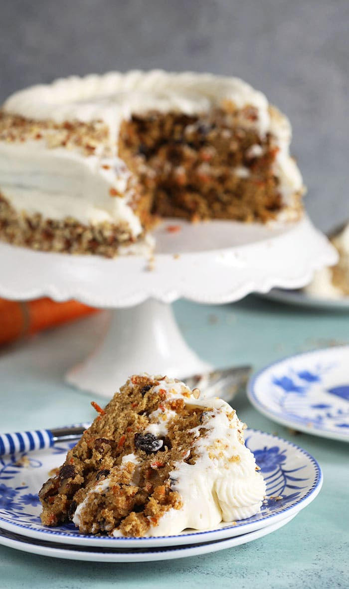 Carrot Cake Layer cake with a slice on a blue and white plate.