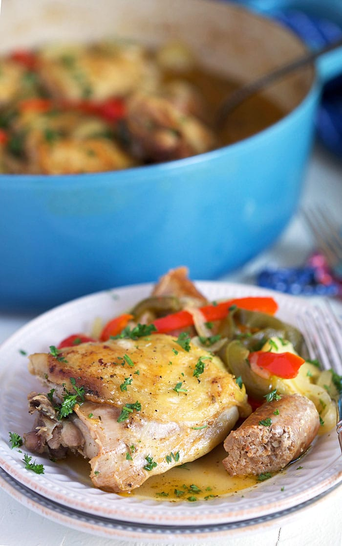 Chicken Scarpariello on a white plate.