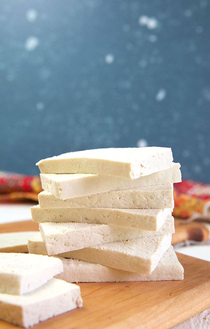 Pieces of tofu are stacked on top of one another.