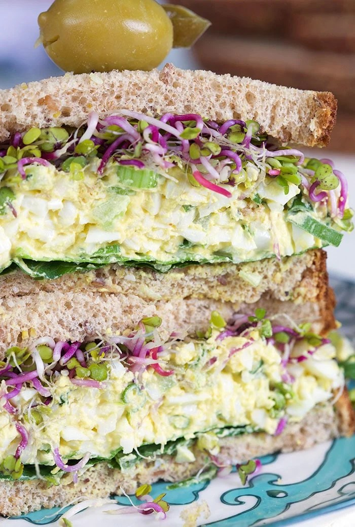 Close up of egg salad on a sandwich.