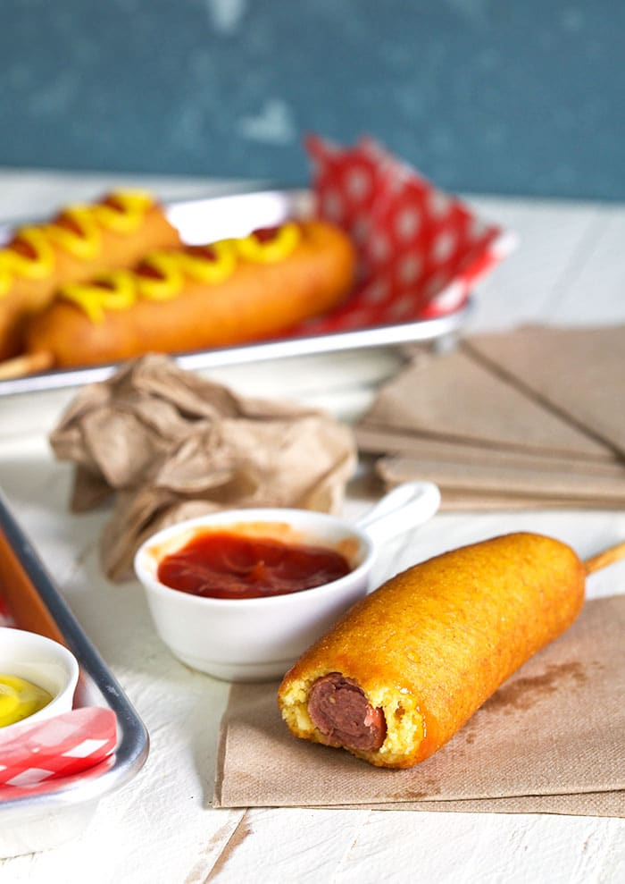Corn dog with a bite out of it.