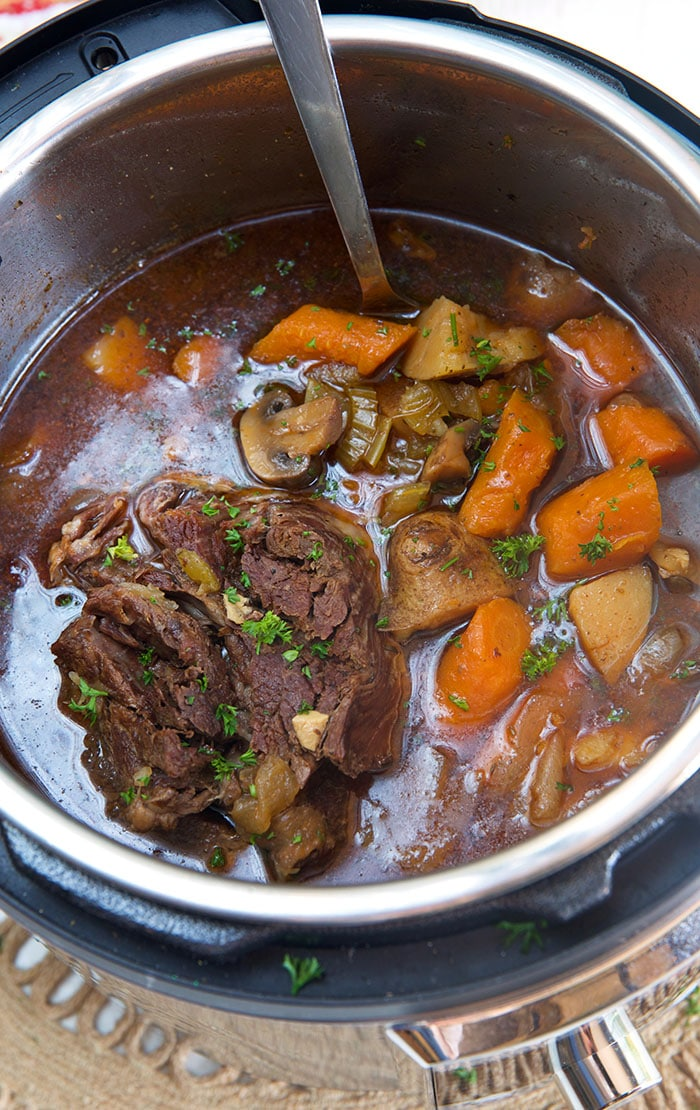 Close up of pot roast and vegetables in an Instant Pot.