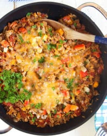 Overhead shot of stuffed pepper casserole in a black skillet.