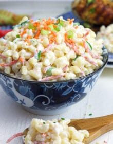 Hawaiian Macaroni Salad in a blue and white bowl with a wooden spoon.