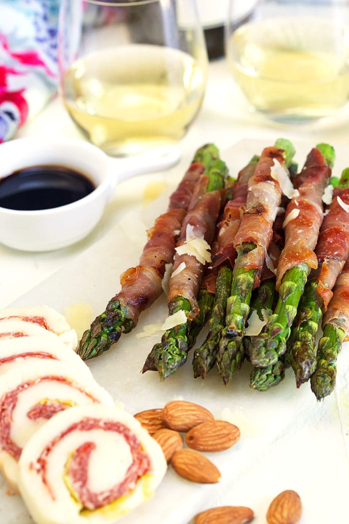 small charcuterie board with prosciutto wrapped asparagus