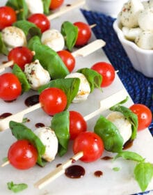 Caprese Salad Skewers on a marble board.
