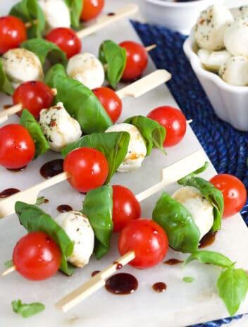 Caprese Salad Skewers on a marble board.