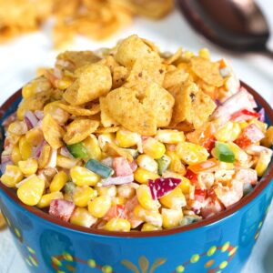 Top down shot of Frito corn salad in a blue bowl.