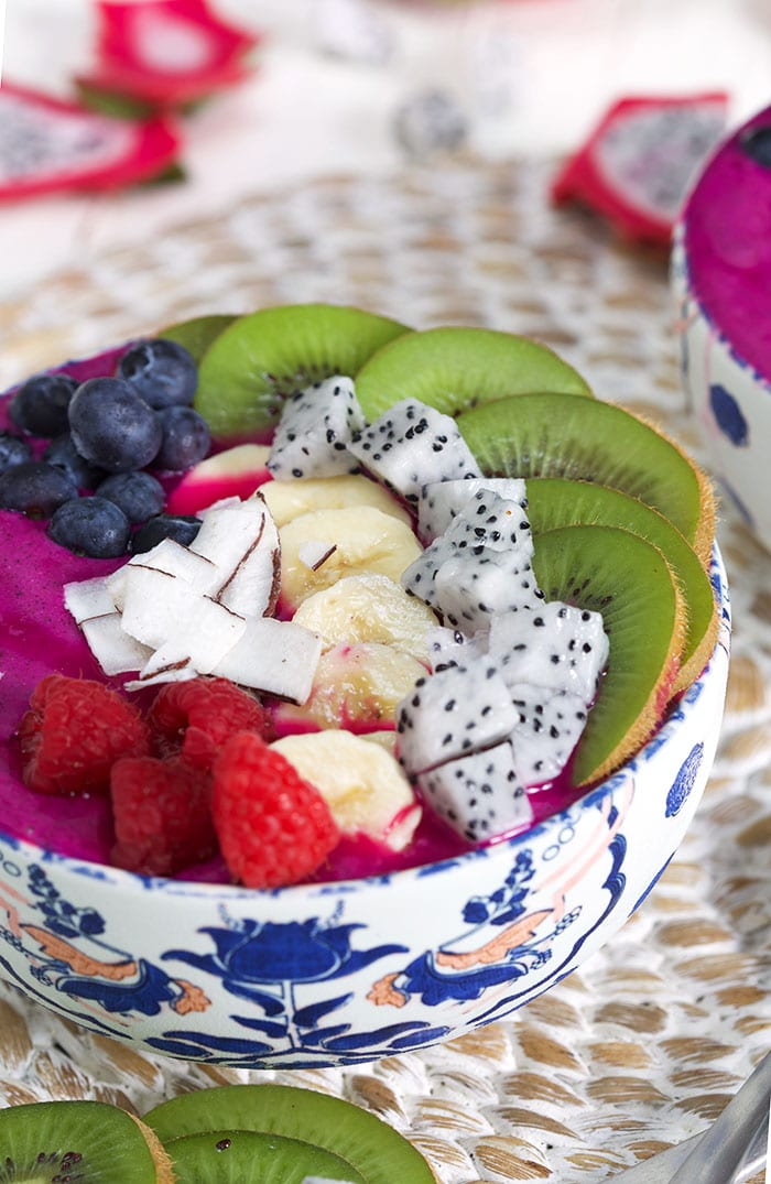 Close up of Pitaya smoothie bowl with fresh fruit on top.