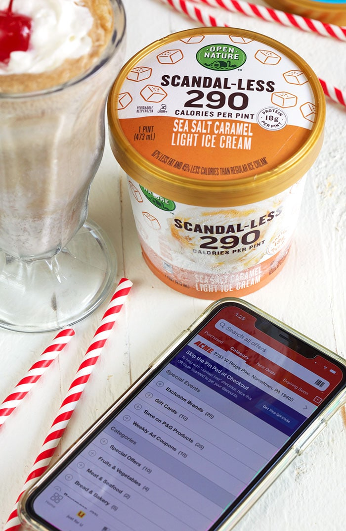 iPhone with Acme market app and a pint of Open Nature ice cream.