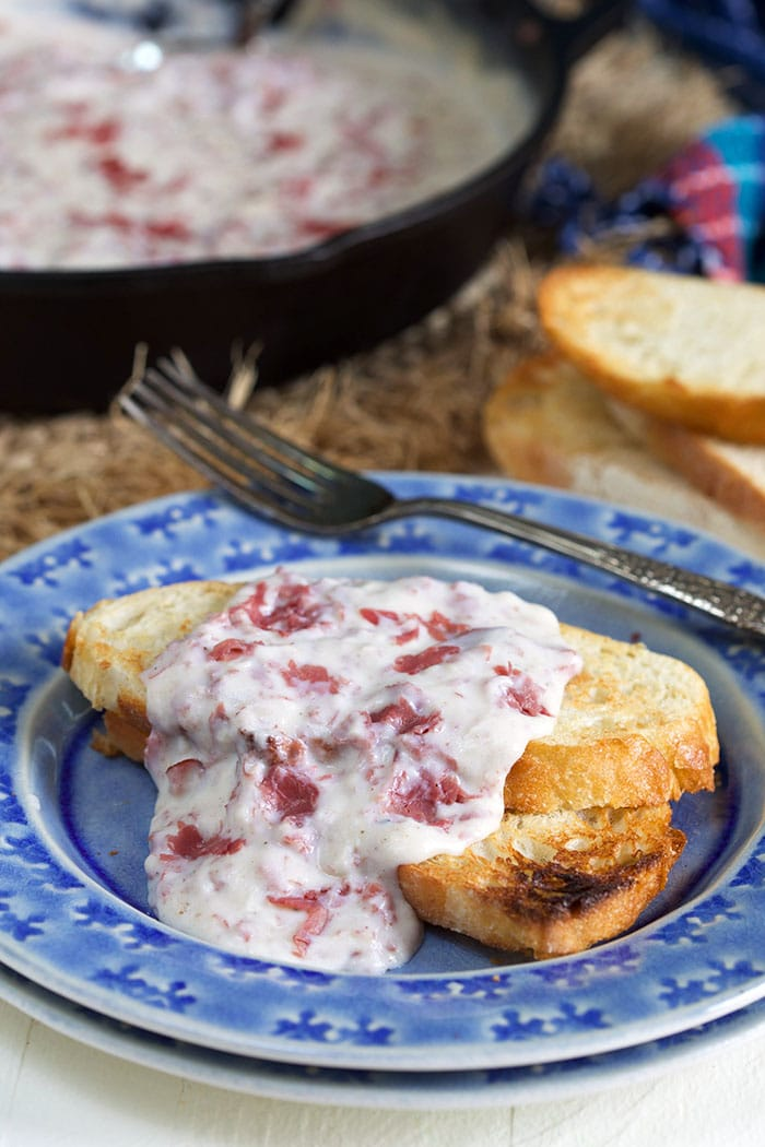 Creamed Chipped Beef on toast on a blue plate.