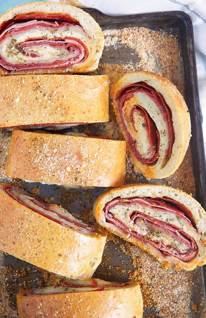 Stromboli sliced up on a baking sheet.