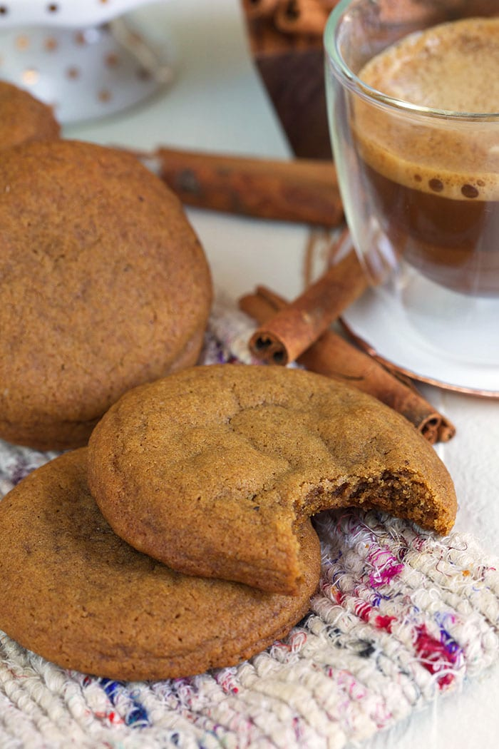 Ginger snap cookies on a tweed blanket.