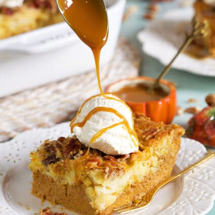 Pumpkin Crunch Cake being drizzled with caramel sauce.
