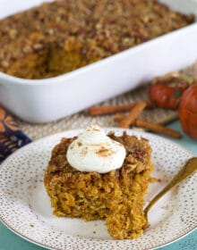 Pumpkin Baked Oatmeal slice on a white plate with a gold fork.