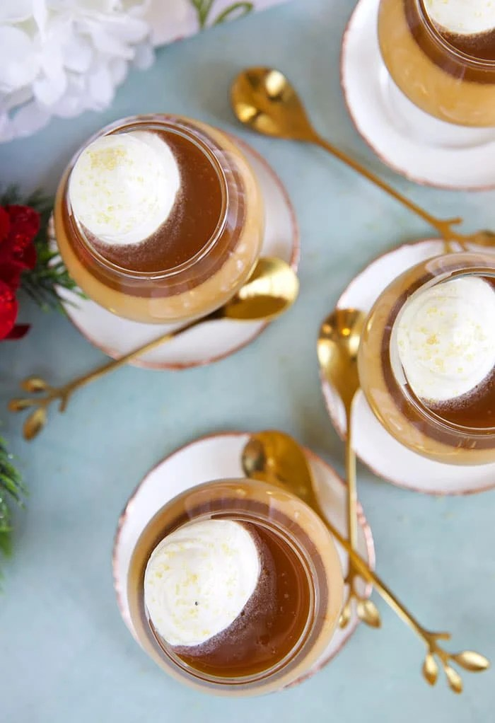 Overhead photo of butterscotch pot de creme with whipped cream on top.