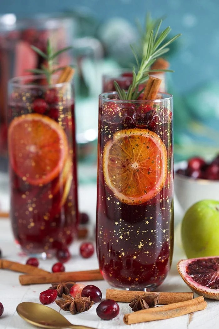 Christmas Sangria in a champagne glass with blood oranges and cranberries.