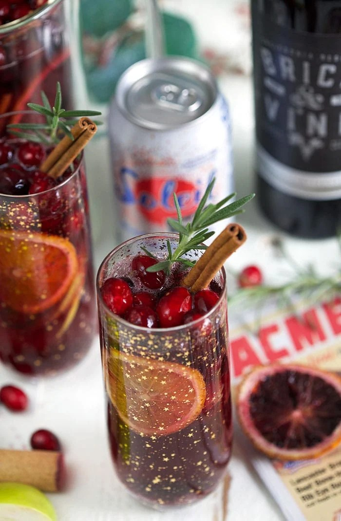 Christmas Sangria on an ACME flyer with a can of sparking water in the background.