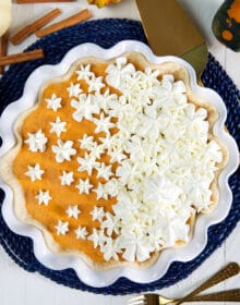 pumpkin chiffon pie on a blue placemat.