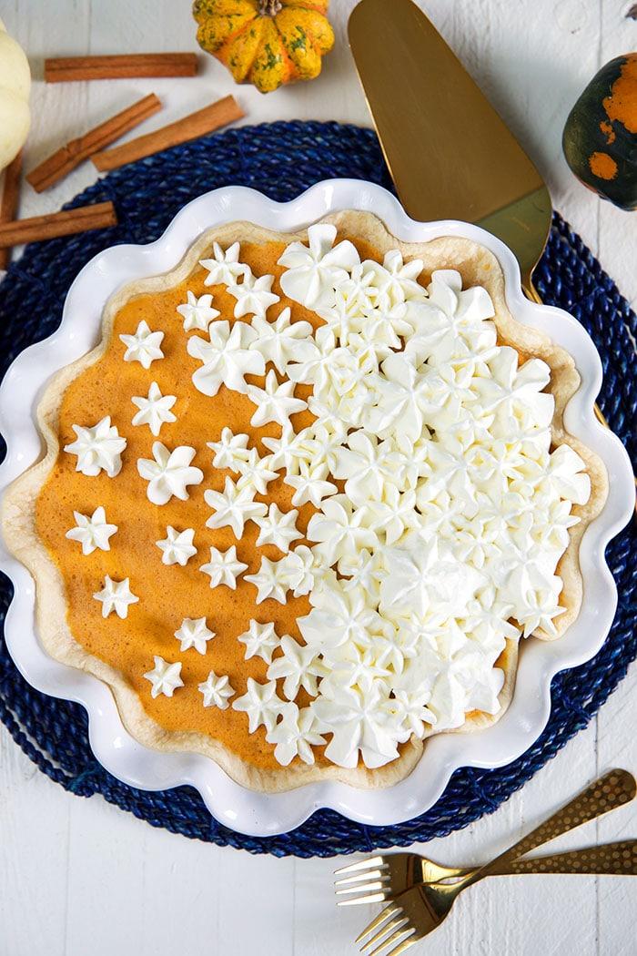 pumpkin chiffon pie on a blue placemat.