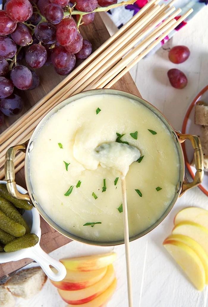 Swiss cheese fondue in a copper pot.