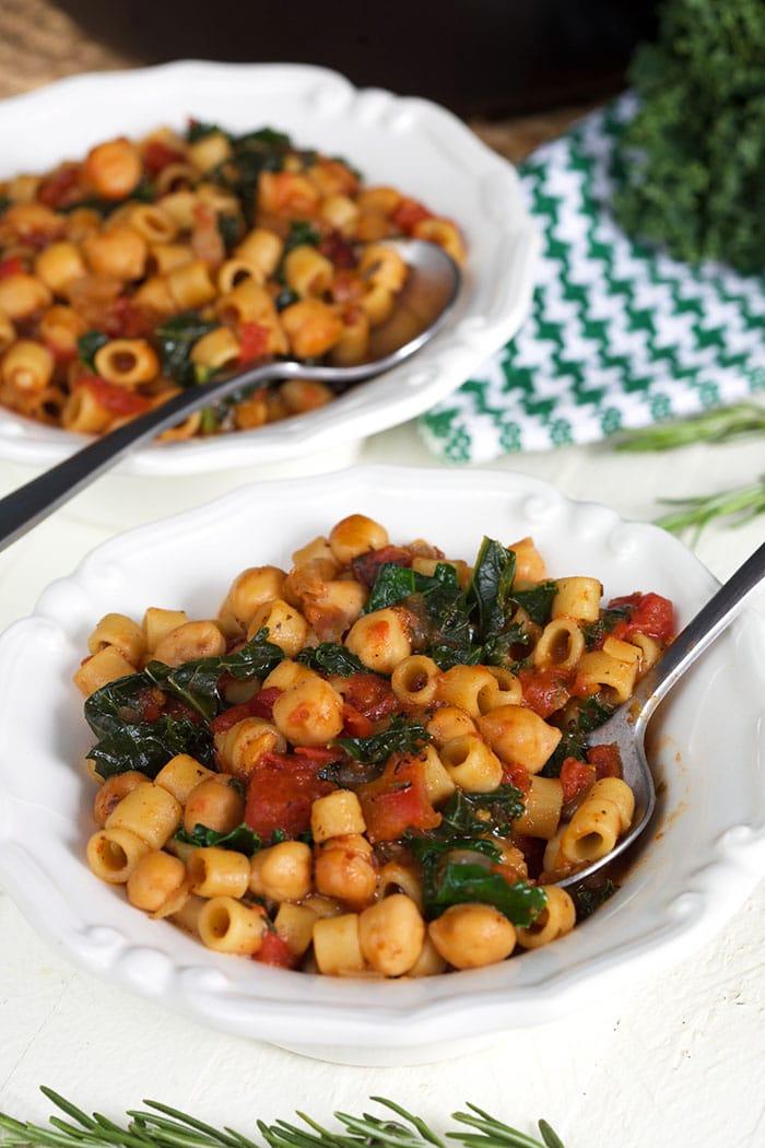 pasta e ceci in a white bowl with a spoon