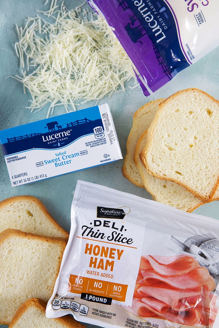 ingredients for croque madame on a blue background
