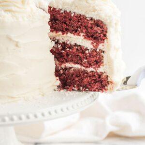 slice of red velvet cake being served with a cake server
