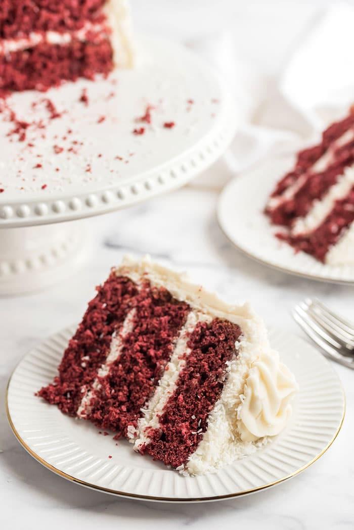 slice of red velvet coconut cake on a white plate