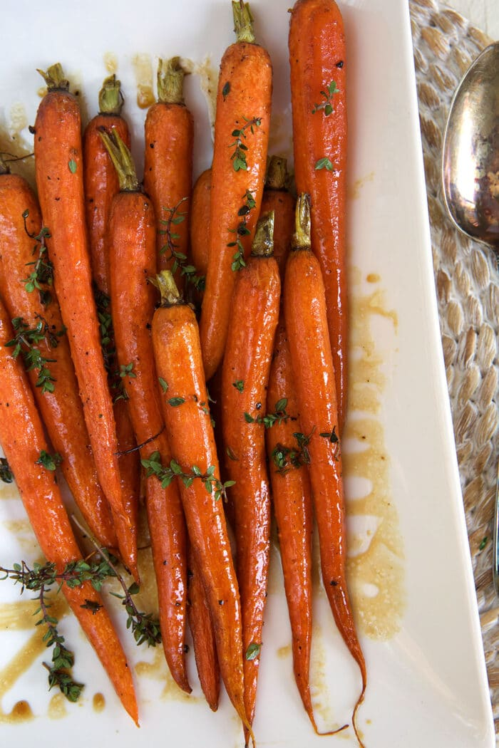 Baked carrots are placed on a serving platter.